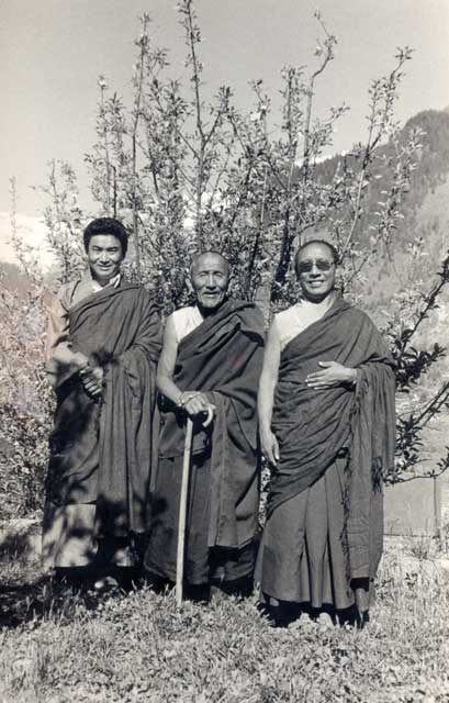 An old photo of Sey Rinpoche, who is the reincarnation of Tripon Pema Choegyal, the guru of Yogi Gen Khyentse and Sengdrak Rinpoche, standing in the middle and on the right of this photo