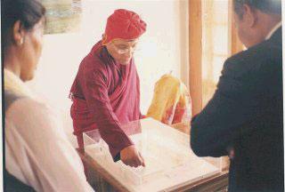 Looking at the building plans of Druk Padma Karpo Institute in Shey, July 2002